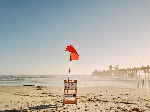 ocean sunset beach sign pier sand surf waves lifeguard oceanside bigwaves oceansidepier