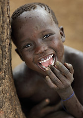 Ethiopia, happy Mursi boy