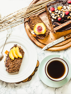 piece of chocolate cake with pumpkin, nuts and fresh peaches, top view