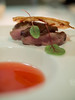 Roasted cherry village duck breast, spiced strawberry consommé, crispy bacon chip
