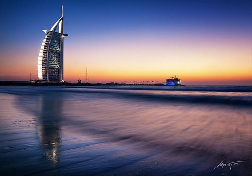 sunset sea tower beach skyscraper lights sand nikon dubai top uae tokina emirates arab luxury hdr burj blending niksoftware d300s mydubai simplyabudhabi