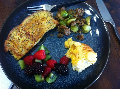 We made brunch: Lemon poppy seed french toast, brussels sprout hash, cheese souffle, and fresh fruit.
