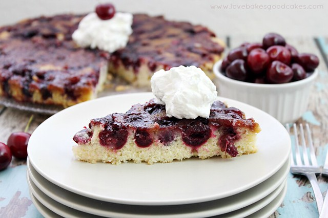 With a tender crumb butter and sour cream cake, this Cherry Upside Down Cake is the perfect way to welcome cherry season! It's especially delicious warm! #cherries #cake #upsidedowncake #SummerDesserts