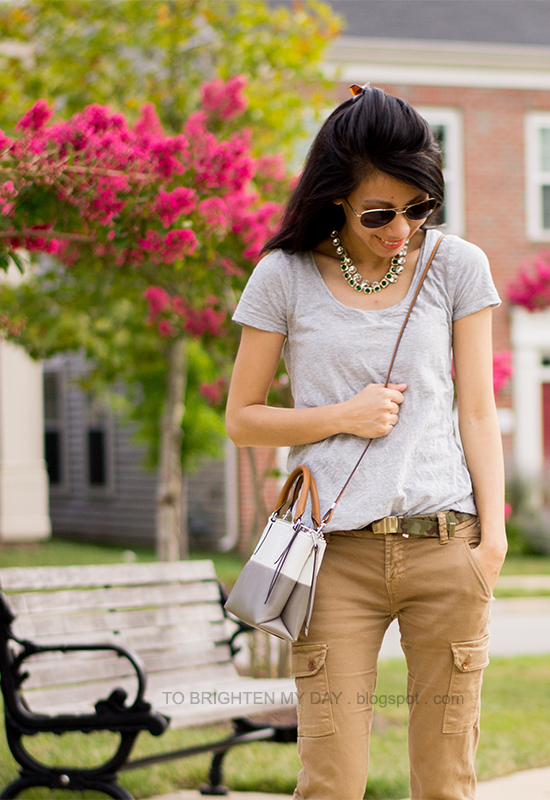 layered necklace, gray tee, camo belt, cargo pants