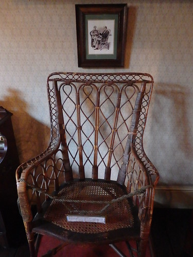"The original cane chair used by the artist Sidney Paget for his illustration of Sherlock Holmes in ""The Greek Interpreter."""