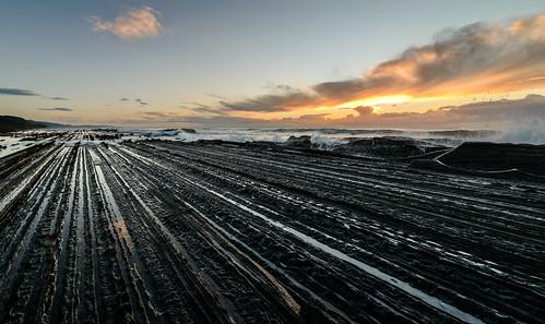 light newzealand sky water clouds sunrise dawn rocks tide castlepoint wairarapa