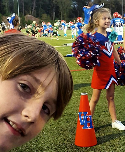 Oh these kids.... Tristan can't help but laugh at her big brother Cooper, while photo bombing! #homecoming #cheerleading #vestaviahillsrebels #littlerebels #vestaviahills