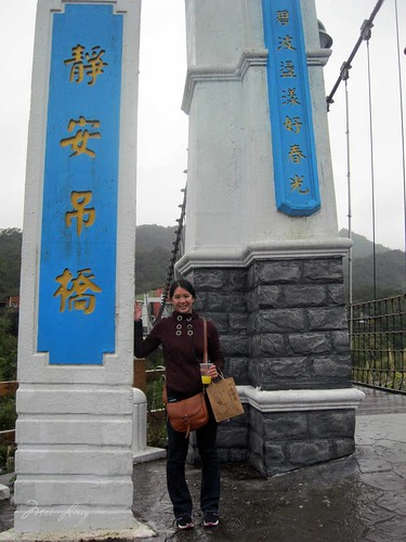 Mei by the entrance to the suspension bridge
