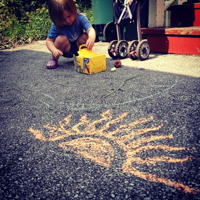 I doodled her school logo in orange chalk.