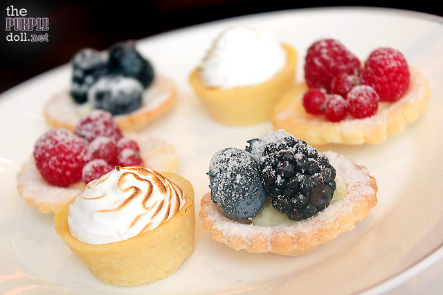 Seasonal Tartlets Lemon Meringue, Blueberry-Black Raspberry Tart, and Cranberry-Raspberry Tart