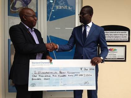 Cecil Sunkwa – Mills, General Manager presents a cheque to Daniel Afari- Counselor at Leukemia Foundation