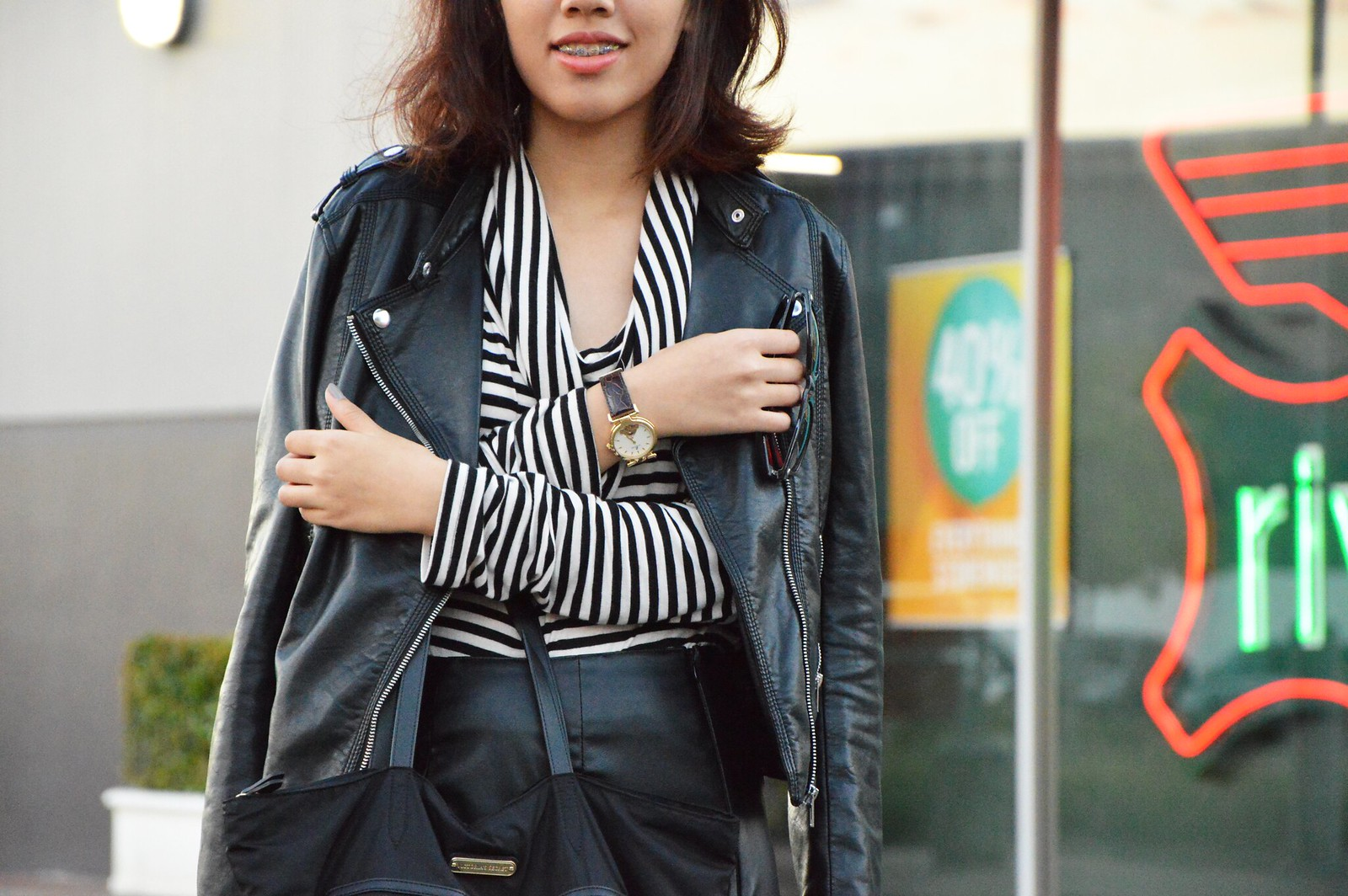 black leather jacket, leather skirt, striped turtleneck sweater