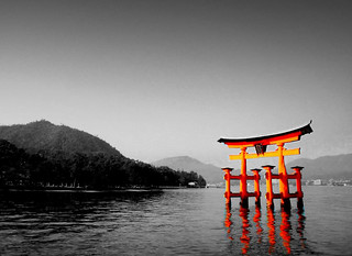 Image of Itsukushima Shrine near Miyajima. bw cameracanonpowershotsd800is floatinggate hiroshima itsukushimashrine japan miyajima ocean religion selectivecolor shinto toriigate trip vacation water year2008 2008