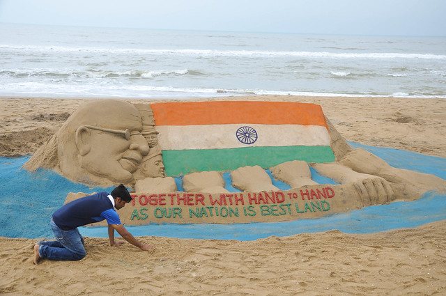 Sand sculpture on the eve of 68th Independence Day on the Golden sea beach Puri