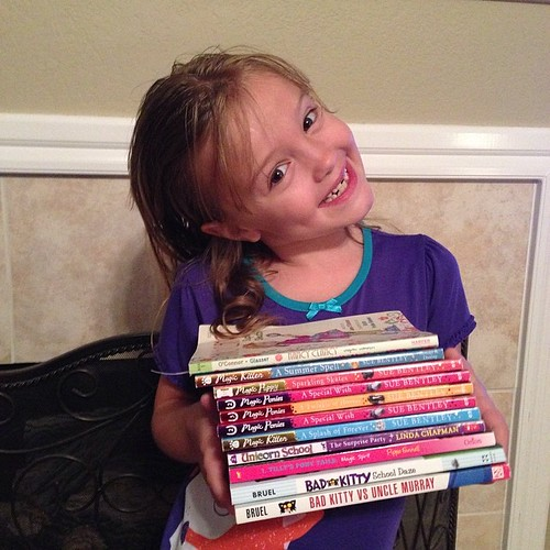 227:365 This kid & her love of books... these are the ones she has read over the last few weeks.