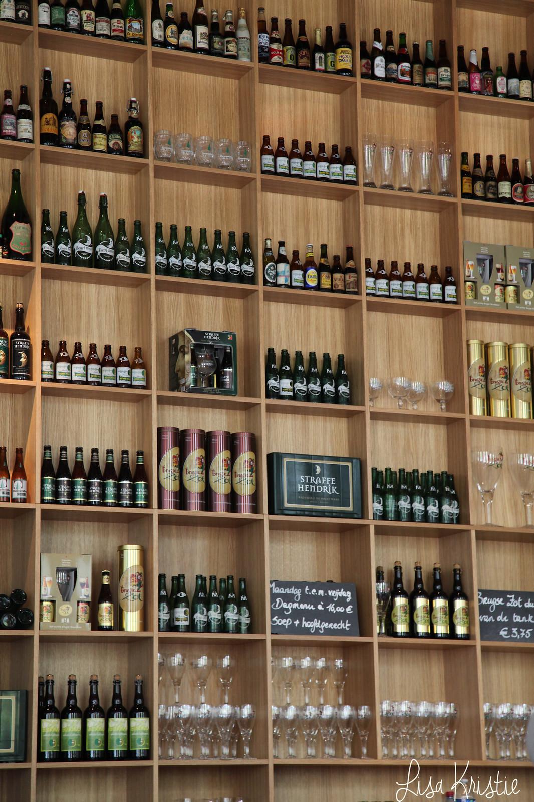Brewery / Restaurant De Halve Maan brugge bruges belgium Huisbrouwerij Walplein 26 interior inside wall beer bottles high ceiling