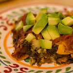 kale and potato enchiladas with roasted chile sauce