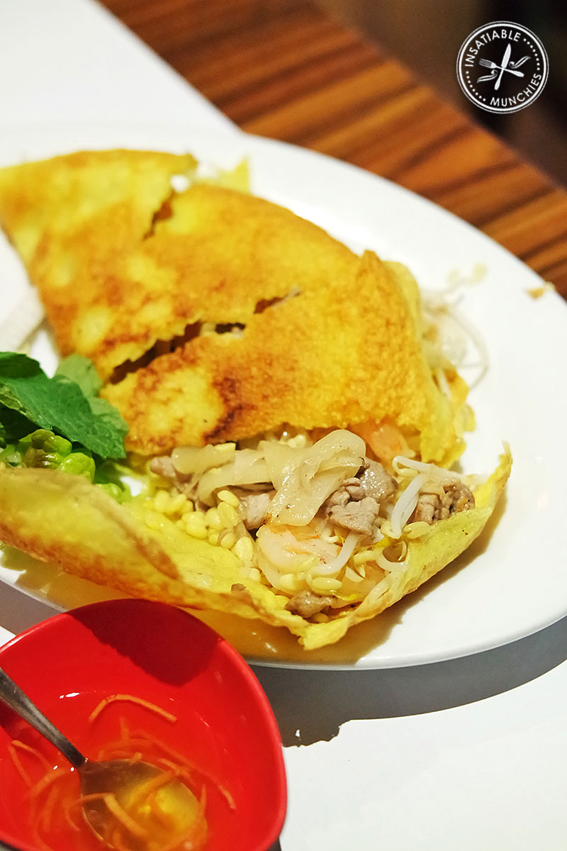 Authentic specialty pancake filled with prawns, pork, bean sprouts and served with salad, pickles and fish sauce. The light and crispy pancake makes this a repeat favourite