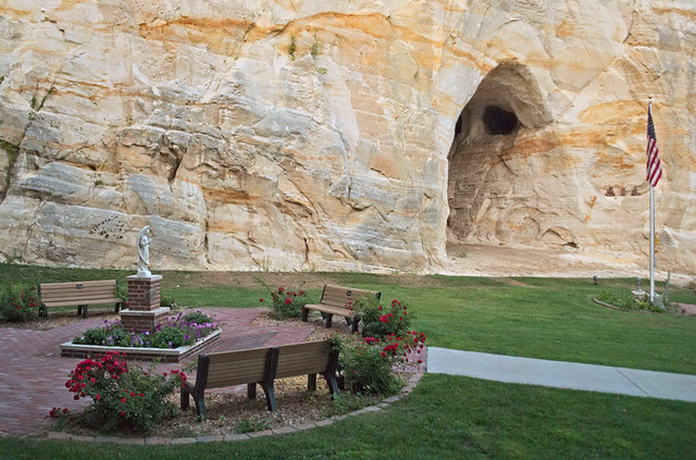 A.D.A.M.'s Garden, in Pacific, Missouri, USA - view of angel rose garden and cave in sandstone bluff