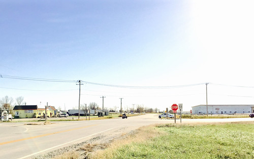 america middle country rural gardner illinois town intersection stop sign telephone wires electric poles november 2016