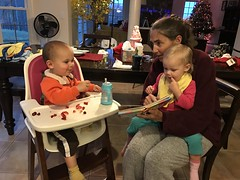 Amber reads to Madeleine while Sawyer eats a snack