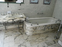 floor, countertop, room, property, jacuzzi, bathtub, plumbing fixture, tile, bathroom, flooring, sink,