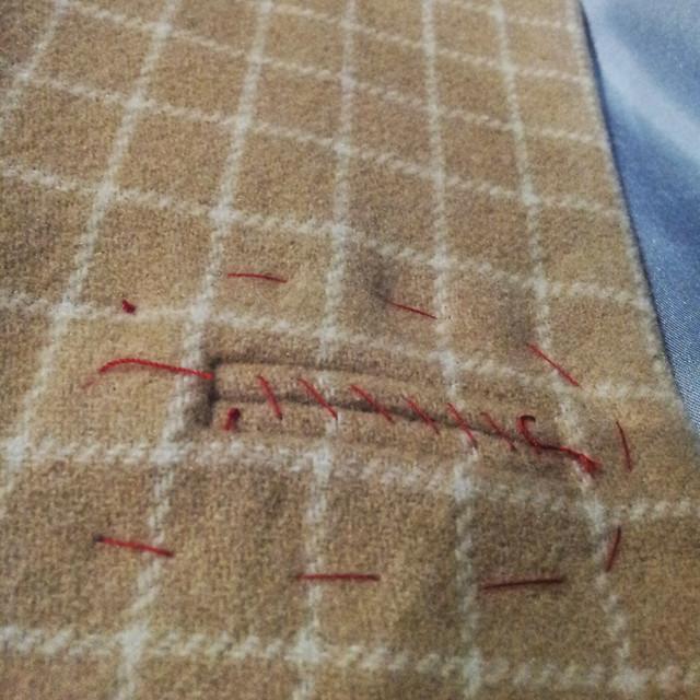 baste around buttonholes