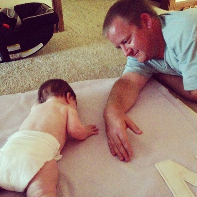 Daddy showed her what to do...and she FINALLY did it. Apparently she just needed some extra instruction. :) #bellytoback #6monthsold #ellieclaire