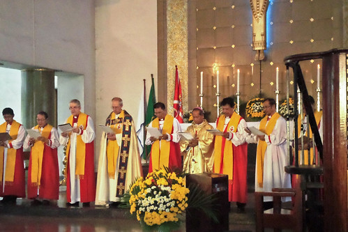 Seven bishops concelebrating and the Archbishop presiding in the Holy Eucharist