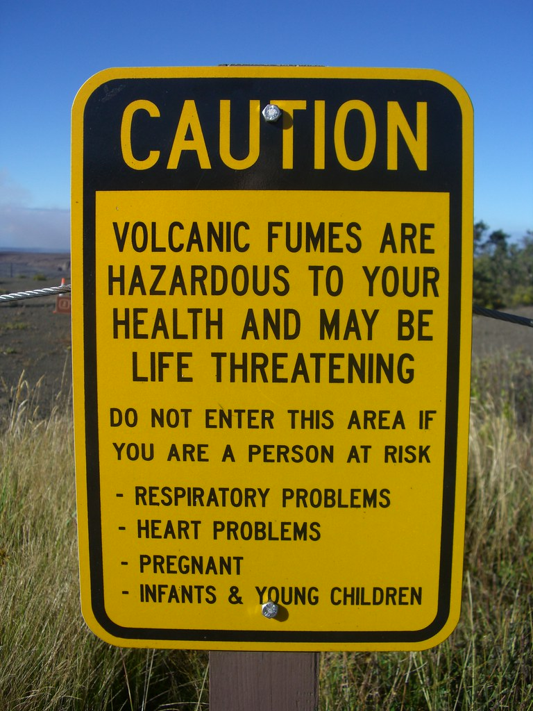 Caution sign at the Volcanoes National Park