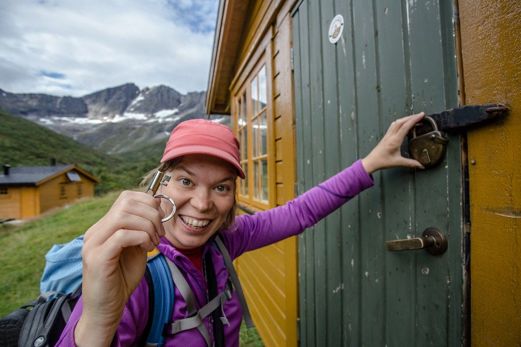 Happy backpacker with a key! Velleseter hytte. Sunnmøre Alps.