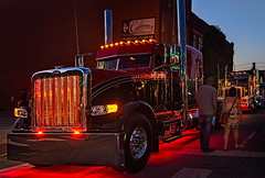 """2015 Peterbilt """"Contender"""" with lights on during the 34th annual Rotella SuperRigs light show in downtown Joplin Missouri"""