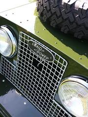 window(0.0), rim(0.0), windshield(0.0), tire(1.0), automotive tire(1.0), automotive exterior(1.0), wheel(1.0), vehicle(1.0), automotive lighting(1.0), light(1.0), grille(1.0), bumper(1.0), headlamp(1.0),