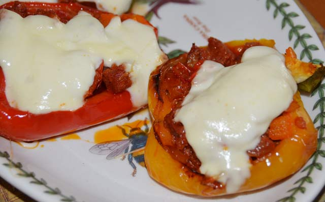 red and yellow pepper halves with chorizo filling topped with cheese