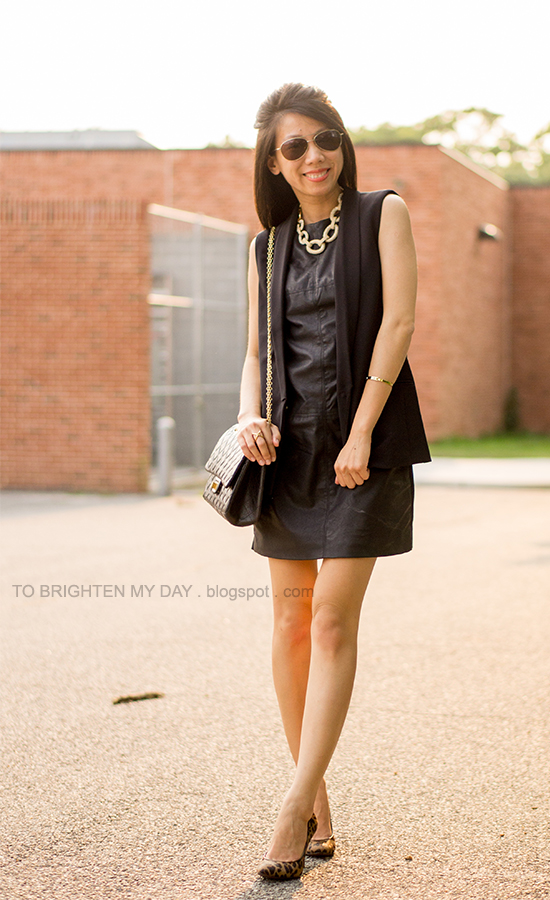 sleeveless vest, faux leather dress, statement necklace, leopard pumps