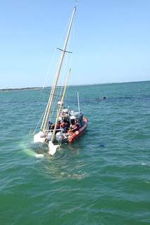 A Coast Guard Station Brant Point crew rescues four sailors from the water after their 40-foot sailing vessel sank in Nantucket Harbor, Mass., Aug. 8, 2014. The sailors notified the Nantucket harbormaster via VHF radio that they had come into contact with another vessel and were taking on water in Nantucket Harbor at about 10:50 a.m. A Station Brant Point 25-foot Response Boat-Small crew already underway, immediately diverted, rescued the four sailors from the water, and safely returned them to Station Brant Point. (U.S. Coast Guard photo by Station Brant Point)
