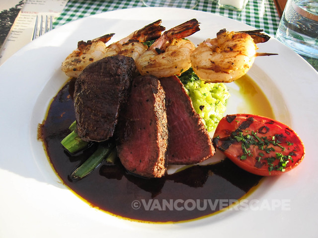 Beef tenderloin, grilled jumbo tiger prawns, seasonal veggies