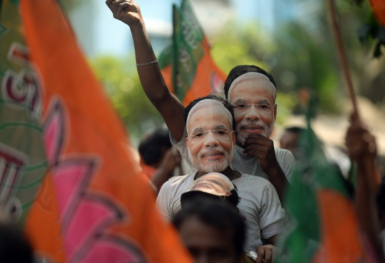 Narendra Modi's supporters celebrate the BJP's victory in the 2014 election in Mumbai. Photo credit: AFP