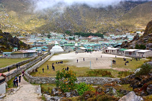 Soccer field at The Hillary School in Khumjung flanked by tablets of Buddhist mantras