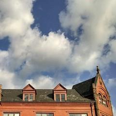 Red, white & blue.  #boston #architecture #brick #gables #igersboston #cloudporn #sky