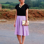 Over 40 Fashion: Black tee with lilac skirt and gold accessories