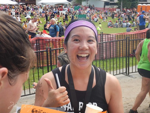 Mei excited that she finished the race. Thumbs up.