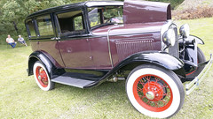 ford model a(0.0), touring car(0.0), sedan(0.0), automobile(1.0), ford model a(1.0), vehicle(1.0), antique car(1.0), classic car(1.0), vintage car(1.0), land vehicle(1.0), luxury vehicle(1.0), ford model t(1.0), motor vehicle(1.0),