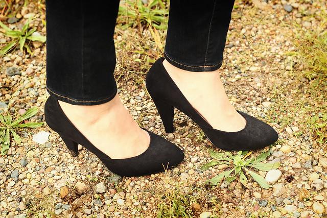 Black coat white shoes cadillac