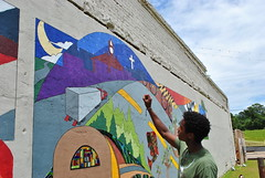 Jelani Moore shares the details of the mural design. The first Elba Renaissance Festival brought the town�s residents together for a six-day community mural-painting.