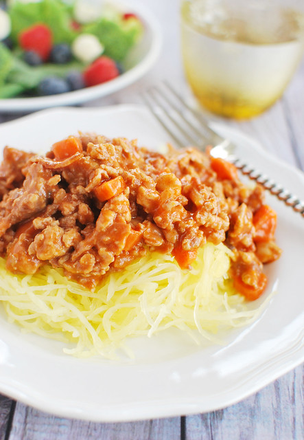 Spaghetti Squash Bolognese - your favorite pasta dish made healthier! Rich paleo bolognese on top of spaghetti squash noodles - you won't even miss the pasta!