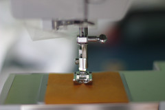 design(0.0), sewing(1.0), sewing machine(1.0), art(1.0), green(1.0),
