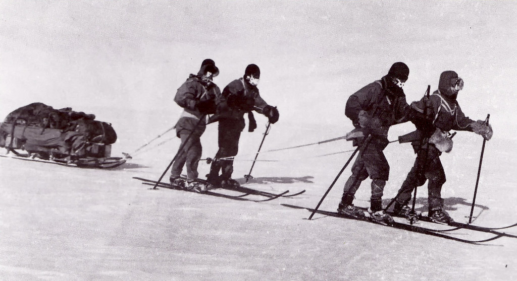 The South Pole team hauling their sleds on the way back to base camp
