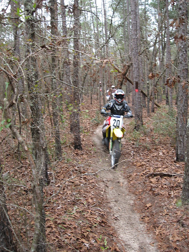 A local motorcycle enthusiast runs one of the motorized trails on the Apalachicola National Forest near Tallahassee, Fla. The forest features approximately 111 miles of trails for motorcycles, all-terrain vehicles and other off-highway vehicles. (U.S. Forest Service Photo/Susan Blake)