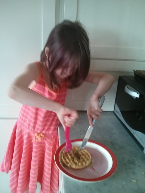 Making her own breakfast